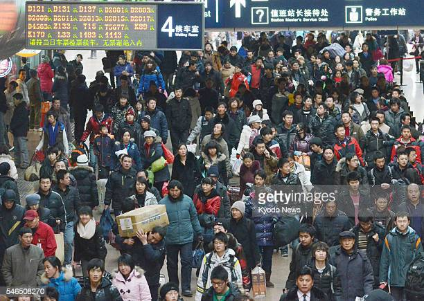 BEIJING China Workers and students walk through a concourse at Beijing West station on Jan 18 2011 An estimated 285 billion people will have likely...