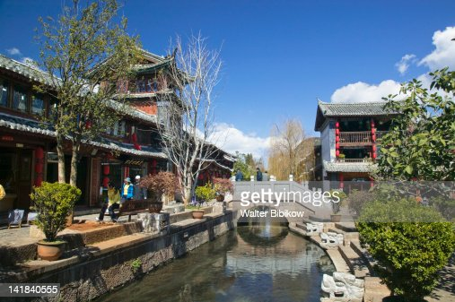 China, Yunnan Province, Lijiang, Buildings along Yu River Canal : Stock Photo