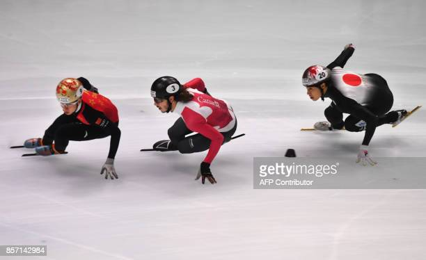 China'a Han Tianyu Canada's Samuel Girard and Japan's Ryosuke Sakazume compete during the final competition in the 'Men 5000m Relay' category at the...