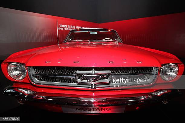 ChinaAutoShowMustang50FOCUS by Julien GIRAULT This photo taken on April 19 2014 shows a 1965 Ford Mustang Convertible car on display at the 50years...