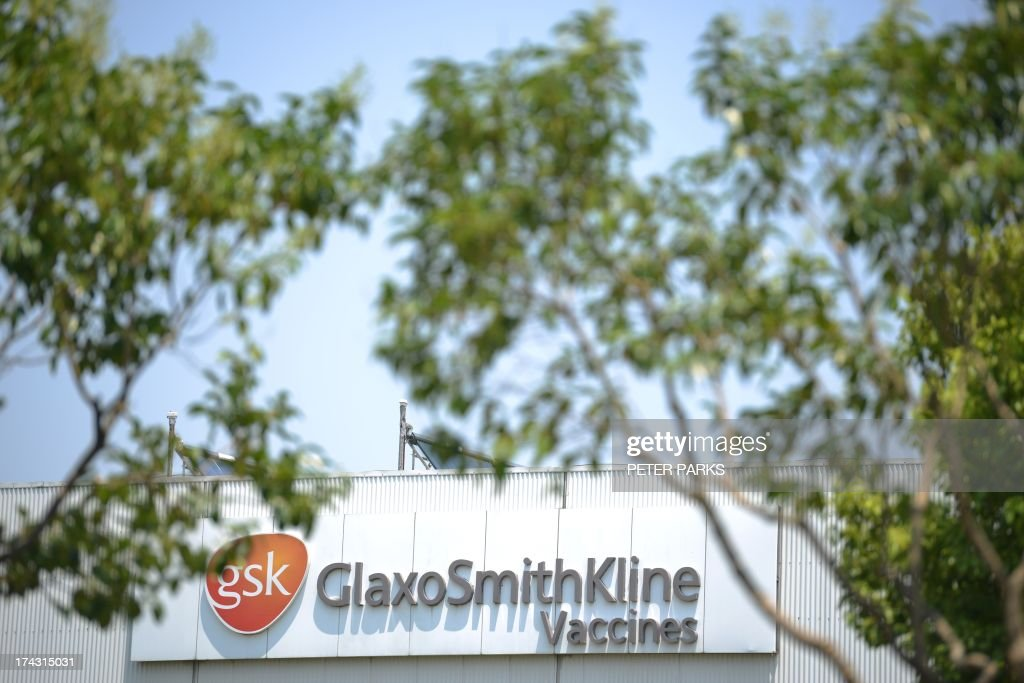 China-Britain-corruption-pharmaceutical-GSK by Bill SAVADO Photo taken on July 23, 2013 shows British pharmaceutical giant GlaxoSmithKlines factory in Shanghai. Beijing's targeting of GlaxoSmithKline in a high-profile bribery probe is a reminder of the risks foreign companies face when seeking the huge rewards of China's market, analysts say. AFP PHOTO/Peter PARKS