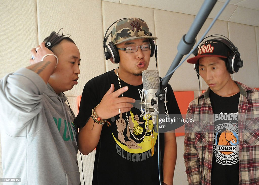 STORY 'China-culture-music,FEATURE' BY TOM HANCOCK This picture taken on August 21, 2012, shows rappers (L-R) Beggar, Sodmuren and Mars (L-R) from hip-hop band 'Poorman' recording their music in Hohhot, north China's Inner Mongolia region. Members of China's Mongolian ethnic minority, whose ancestors were first united by Genghis Khan, are turning to hip hop to condemn the resources boom they say is wreaking havoc on their traditions and lands -- while avoiding the authorities' attention.