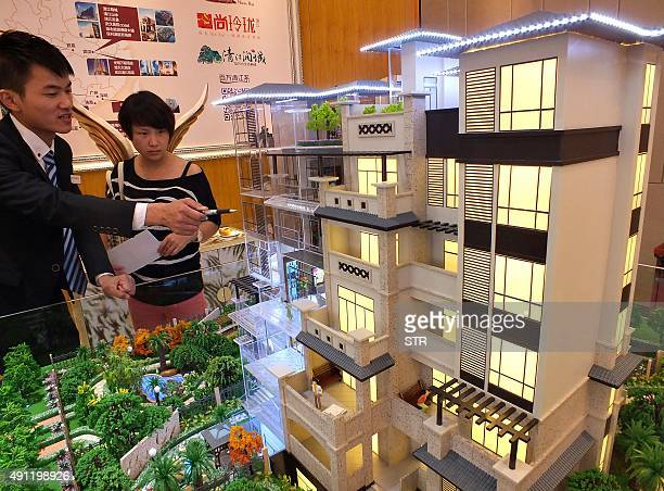 ChinaeconomyGDPFOCUS by Julien Girault This photo taken on October 1 2015 shows a potential Chinese home buyer visiting a housing fair in Yichang in...
