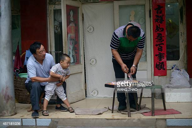 ChinaeconomyhealthfoodlifestyleoffbeatFEATURE by Tom Hancock This picture taken on September 11 2014 shows Li Zhanhua a Chinese farmer checking...