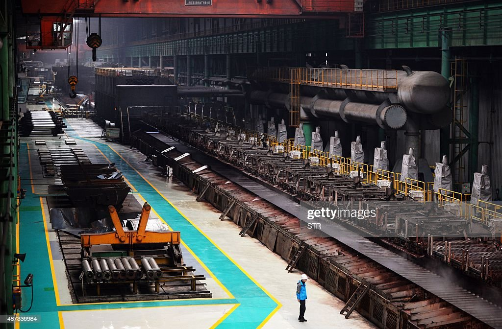 Chinaeconomymanufacturinggrowthsocial FOCUS by Tom Hancock This picture taken on April 11 2015 shows a Chinese worker at steel mill in Tangshan...