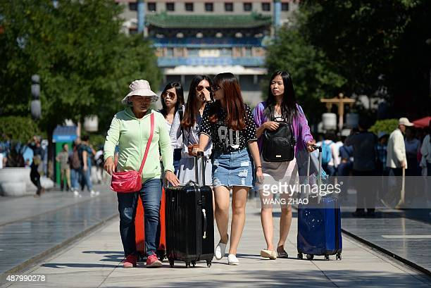 Chinaeconomypolicy ANALYSIS by Bill Savadove A group of women walk along a business street in Beijing on September 13 2015 When Chinese Premier Li...
