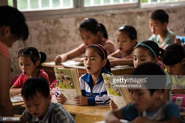ChinaeducationchildreneconomyFOCUS by Johannes Eisele This photo taken on June 19 2015 shows Li Dandan sitting in a classroom of the Xianghe Primary...