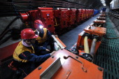 ChinaenvironmentenergypoliticsCongressFOCUS by Carol HUANG This picture taken on March 4 2014 shows laborers working at a coal mining facility in...