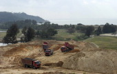 ChinaenvironmentrightslawFEATURE by Tom Hancock This picture taken on January 20 2013 shows dumptrucks at a construction site by the sea in the...