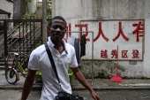 ChinaHongKongAfricaEconomyTradeFEATURE by Rhia Tejpe In a picture taken on August 26 an African man walks down a street in Guangzhou The engines...