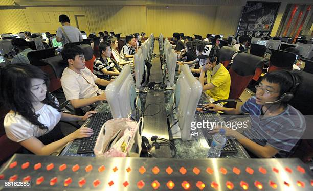 STORY 'ChinaInternetcrimepolicepolitics' By Francois Bougon People use computers at an internet bar in Beijing on June 3 2009 Chinese web users are...