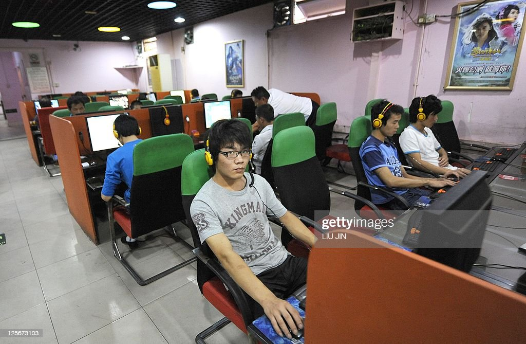 ChinaInternetmediaANALYSIS by Jonathan Landreth A young man uses a computer at an Internet bar in Beijing on September 8 2011 Beijing has moved to...