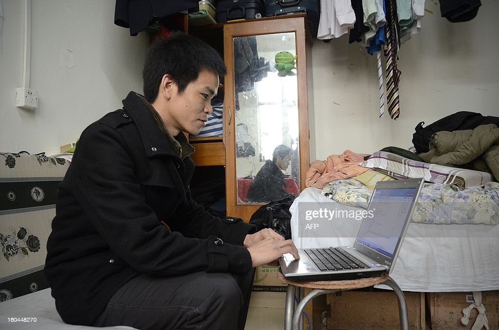 STORY 'China-marriage-lifestyle-social,FEATURE' by Carol Huang This picture taken on January 31, 2013 shows Meng Guangyong using his laptop to operate a boyfriend-broker business online, at his apartment in Beijing. Selling a kiss online, accompanying a stranger overnight for a fee -- none of the 'rent a boyfriend' services popping up on some Chinese websites sound at all family-friendly. Yet the budding market aims to help young singles address the most traditional of values: respecting their elders, meeting their demand to find a mate and bringing him home for the country's biggest holiday, the Lunar New Year. AFP PHOTO / WANG ZHAO