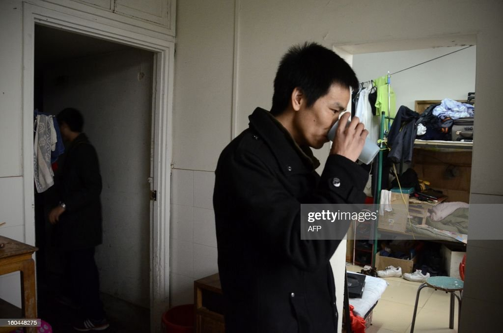 STORY 'China-marriage-lifestyle-social,FEATURE' by Carol Huang This picture taken on January 31, 2013 shows Meng Guangyong drinking tea as he operate a boyfriend-broker business online, at his apartment in Beijing. Selling a kiss online, accompanying a stranger overnight for a fee -- none of the 'rent a boyfriend' services popping up on some Chinese websites sound at all family-friendly. Yet the budding market aims to help young singles address the most traditional of values: respecting their elders, meeting their demand to find a mate and bringing him home for the country's biggest holiday, the Lunar New Year.