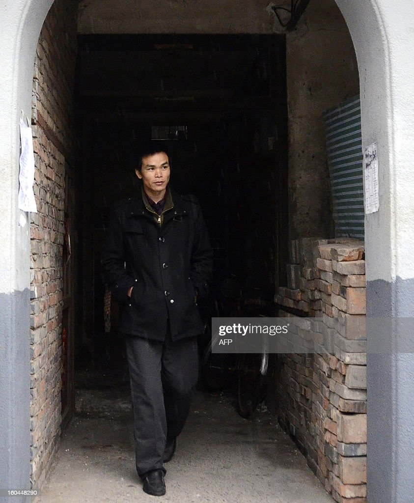 STORY 'China-marriage-lifestyle-social,FEATURE' by Carol Huang This picture taken on January 31, 2013 shows Meng Guangyong who operates a boyfriend-broker business online and is also renting himself out, walking out of his apartment in Beijing. Selling a kiss online, accompanying a stranger overnight for a fee -- none of the 'rent a boyfriend' services popping up on some Chinese websites sound at all family-friendly. Yet the budding market aims to help young singles address the most traditional of values: respecting their elders, meeting their demand to find a mate and bringing him home for the country's biggest holiday, the Lunar New Year. AFP PHOTO / WANG ZHAO