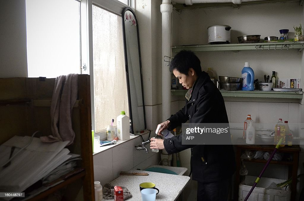 STORY 'China-marriage-lifestyle-social,FEATURE' by Carol Huang This picture taken on January 31, 2013 shows Meng Guangyong who operates a boyfriend-broker business online and is also renting himself out, at his apartment in Beijing. Selling a kiss online, accompanying a stranger overnight for a fee -- none of the 'rent a boyfriend' services popping up on some Chinese websites sound at all family-friendly. Yet the budding market aims to help young singles address the most traditional of values: respecting their elders, meeting their demand to find a mate and bringing him home for the country's biggest holiday, the Lunar New Year.