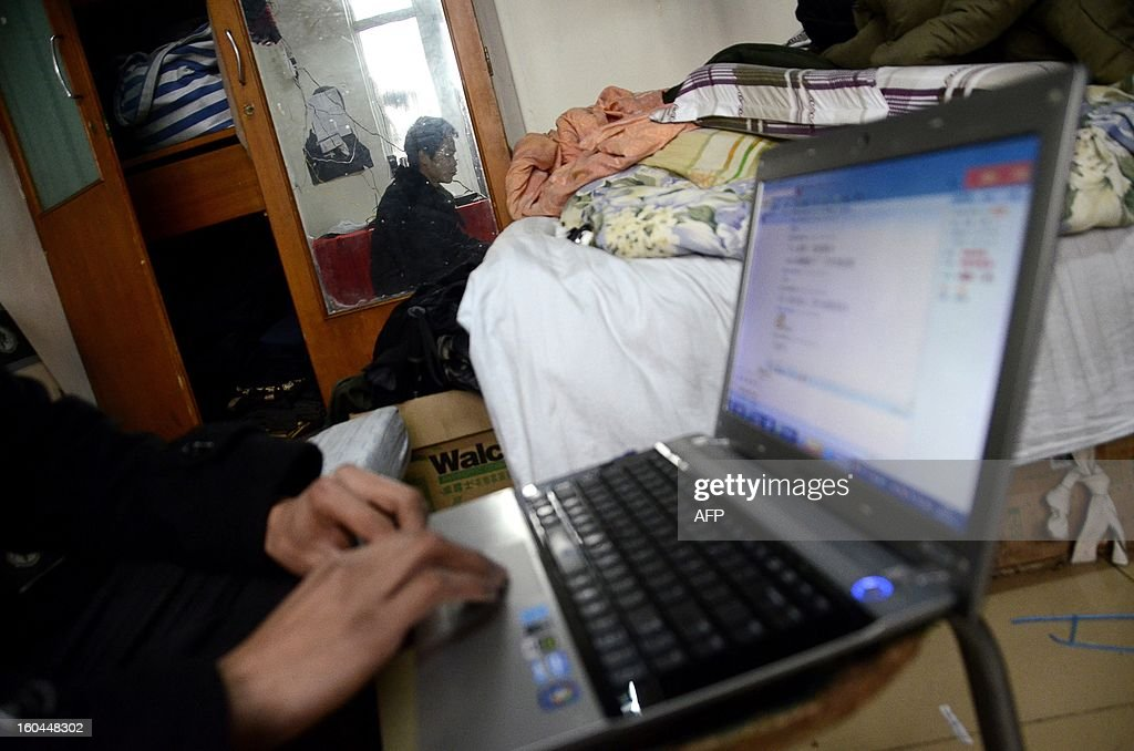 STORY 'China-marriage-lifestyle-social,FEATURE' by Carol Huang This picture taken on January 31, 2013 shows Meng Guangyong using his laptop to operate a boyfriend-broker business online, at his apartment in Beijing. Selling a kiss online, accompanying a stranger overnight for a fee -- none of the 'rent a boyfriend' services popping up on some Chinese websites sound at all family-friendly. Yet the budding market aims to help young singles address the most traditional of values: respecting their elders, meeting their demand to find a mate and bringing him home for the country's biggest holiday, the Lunar New Year.