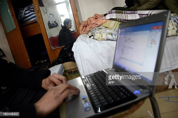 STORY 'ChinamarriagelifestylesocialFEATURE' by Carol Huang This picture taken on January 31 2013 shows Meng Guangyong using his laptop to operate a...
