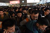 ChinaNewYearsocialtransportrailtechnologyFOCUS In this photo taken on February 13 passengers wait to board a train at Beijing West Railway Station...