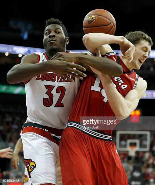 Chinanu Onuaku of the Louisville Cardinals and Ben Lawson of the Western Kentucky Hilltoppers wrestle for the ball during the second half at KFC YUM...