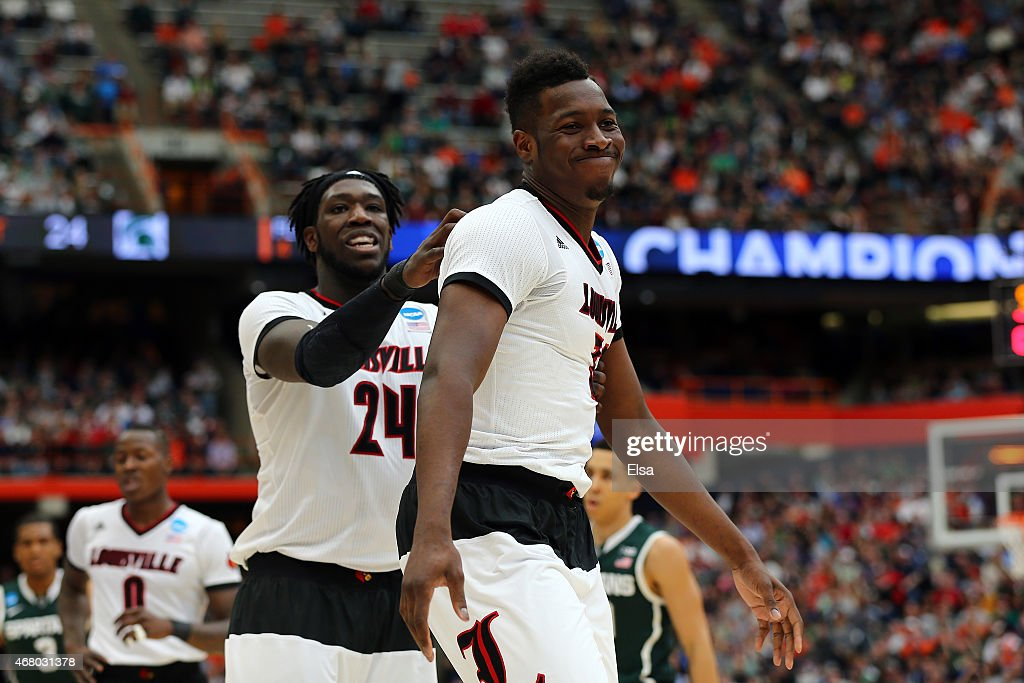 Chinanu Onuaku #32 of the Louisville Cardinals reacts with teammate <a gi-track='captionPersonalityLinkClicked' href=/galleries/search?phrase=Montrezl+Harrell&family=editorial&specificpeople=9959702 ng-click='$event.stopPropagation()'>Montrezl Harrell</a> #24 in the first half of the game against the Michigan State Spartans during the East Regional Final of the 2015 NCAA Men's Basketball Tournament at Carrier Dome on March 29, 2015 in Syracuse, New York.