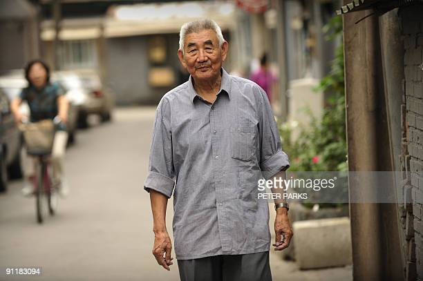 Chinapolitics60yearshistoryINTERVIEW by Dan Martin This photo taken on September 14 2009 shows 79yearold Geng Zhifeng posing outside the tiny brick...