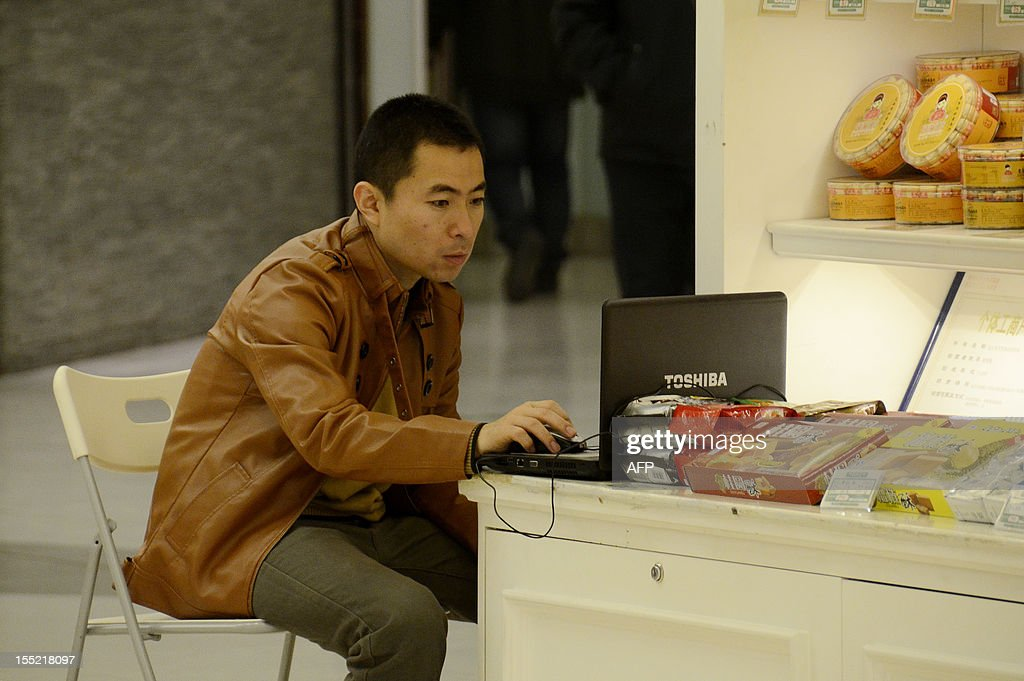 China-politics-congress-Internet,FOCUS by Tom Hancock A man uses his laptop computer at a mall in Beijing on November 2, 2012. China has witnessed explosive growth in Internet usage since the last Communist Party transition in 2002, with the online community of 538 million posing a huge challenge to the party's attempts to shape public opinion. AFP PHOTO / WANG ZHAO