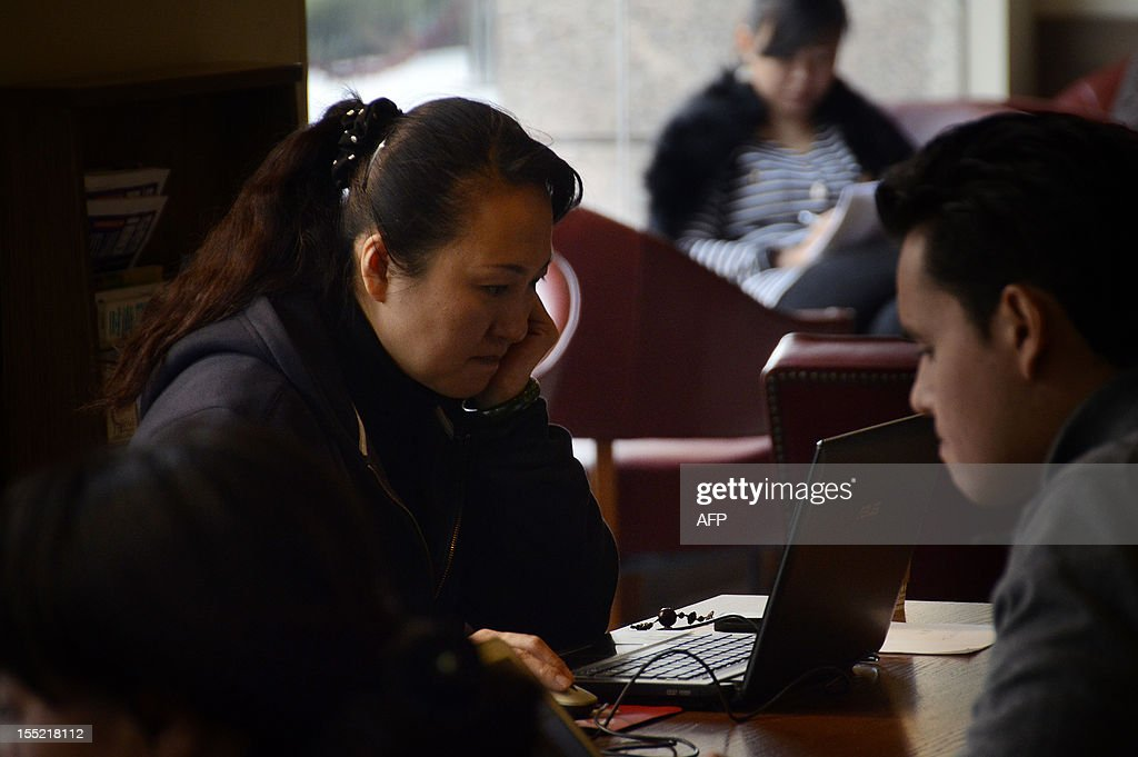 China-politics-congress-Internet,FOCUS by Tom Hancock A woman uses her laptop computer at a cafe in Beijing on November 2, 2012. China has witnessed explosive growth in Internet usage since the last Communist Party transition in 2002, with the online community of 538 million posing a huge challenge to the party's attempts to shape public opinion.
