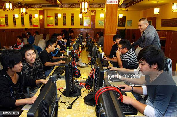 ChinapoliticscongressInternetFOCUS by Tom Hancock This picture taken on November 2 2012 shows a group of people at an Internet cafe in Jiashan east...
