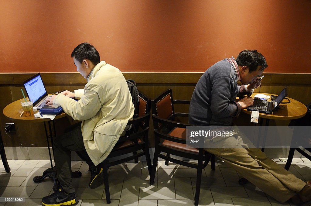 China-politics-congress-Internet,FOCUS by Tom Hancock Two Chinese men use their laptop computers at a cafe in Beijing on November 2, 2012. China has witnessed explosive growth in Internet usage since the last Communist Party transition in 2002, with the online community of 538 million posing a huge challenge to the party's attempts to shape public opinion. AFP PHOTO / WANG ZHAO
