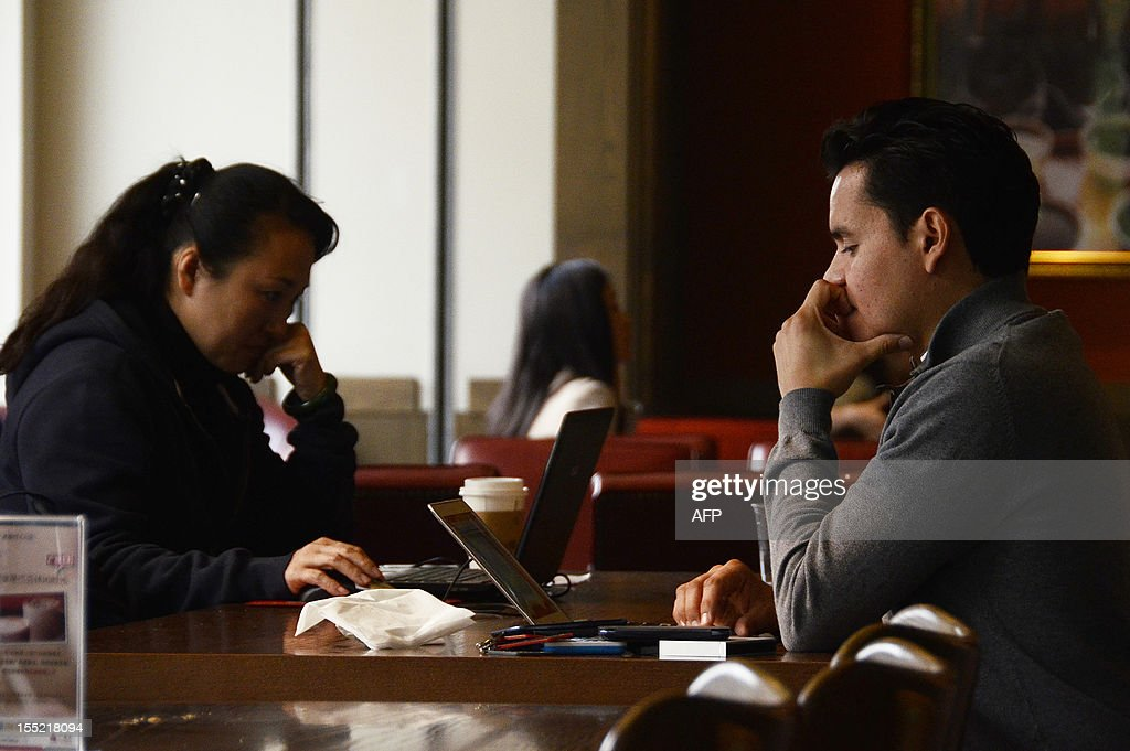 China-politics-congress-Internet,FOCUS by Tom Hancock Two Chinese people use their laptop computers at a cafe in Beijing on November 2, 2012. China has witnessed explosive growth in Internet usage since the last Communist Party transition in 2002, with the online community of 538 million posing a huge challenge to the party's attempts to shape public opinion.