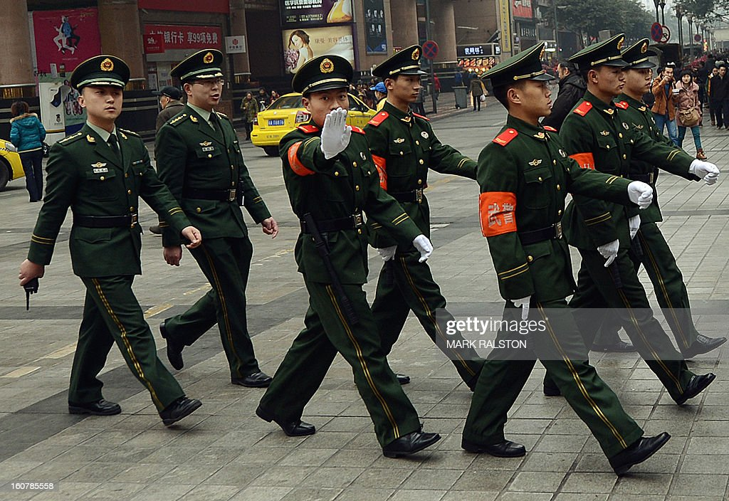 China-politics-corruption-justice-Bo,FOCUS by Neil Connor and Tom Hancock This photo taken on February 3, 2013 shows Chinese paramilitary police marching through the downtown shopping area of Chongqing. A year after Chongqing's police chief set off China's biggest scandal in decades, the megacity has seen revelations of torture, corruption and rights abuses, but little revolutionary change. On February 6, 2012 Wang Lijun fled to a US consulate seeking asylum after falling out with his patron Bo Xilai -- then a member of the ruling Communist Party's elite Politburo, now held at a secret location awaiting trial for crimes including abuse of power and bribery. AFP PHOTO/Mark RALSTON
