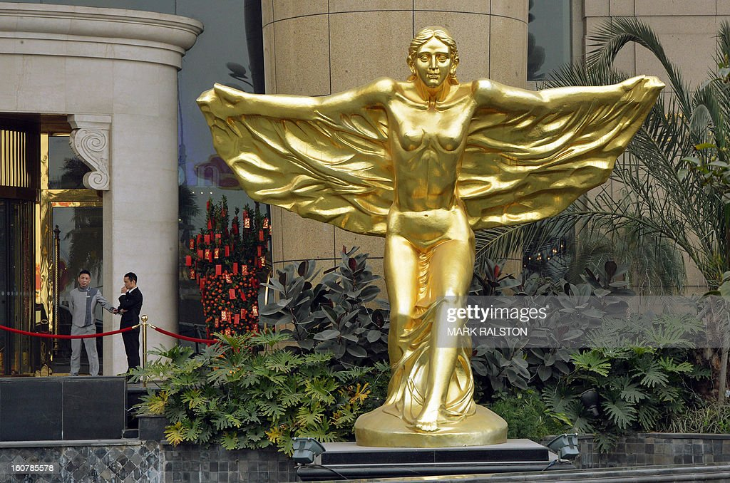 China-politics-corruption-justice-Bo,FOCUS by Neil Connor and Tom Hancock This photo taken on February 4, 2013 shows a guardian angel statue outside a hotel in the Nan'an district which was an area politically loyal to Bo Xilai and one of the two hotels where murdered British businessman Neil Heywood stayed at during his last week alive in Chongqing. A year after Chongqing's police chief set off China's biggest scandal in decades, the megacity has seen revelations of torture, corruption and rights abuses, but little revolutionary change. On February 6, 2012 Wang Lijun fled to a US consulate seeking asylum after falling out with his patron Bo Xilai -- then a member of the ruling Communist Party's elite Politburo, now held at a secret location awaiting trial for crimes including abuse of power and bribery. AFP PHOTO/Mark RALSTON