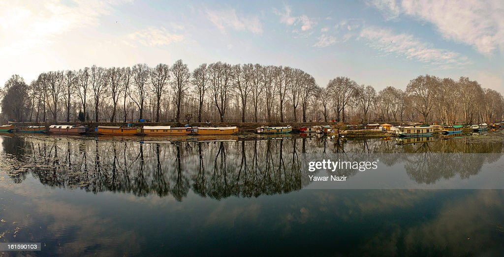 Chinar trees are reflected on the waters of Dal lake during a curfew, imposed after the execution of alleged Indian parliament attacker Mohammad Afzal Guru on February 12, 2013 in Srinagar, the summer capital of Indian Administered Kashmir, India. Afzal Guru, from Sopore town in the north of Kashmir, was hung on February 09 for his role in the 2001 Indian parliament attack which left 14 dead. The hanging has further strained relations between India - who blamed the attack on 'Pakistan backed' militant group Jaish-e-Mohammed - and neighbouring Pakistan and has seen an military increase from both along the border.