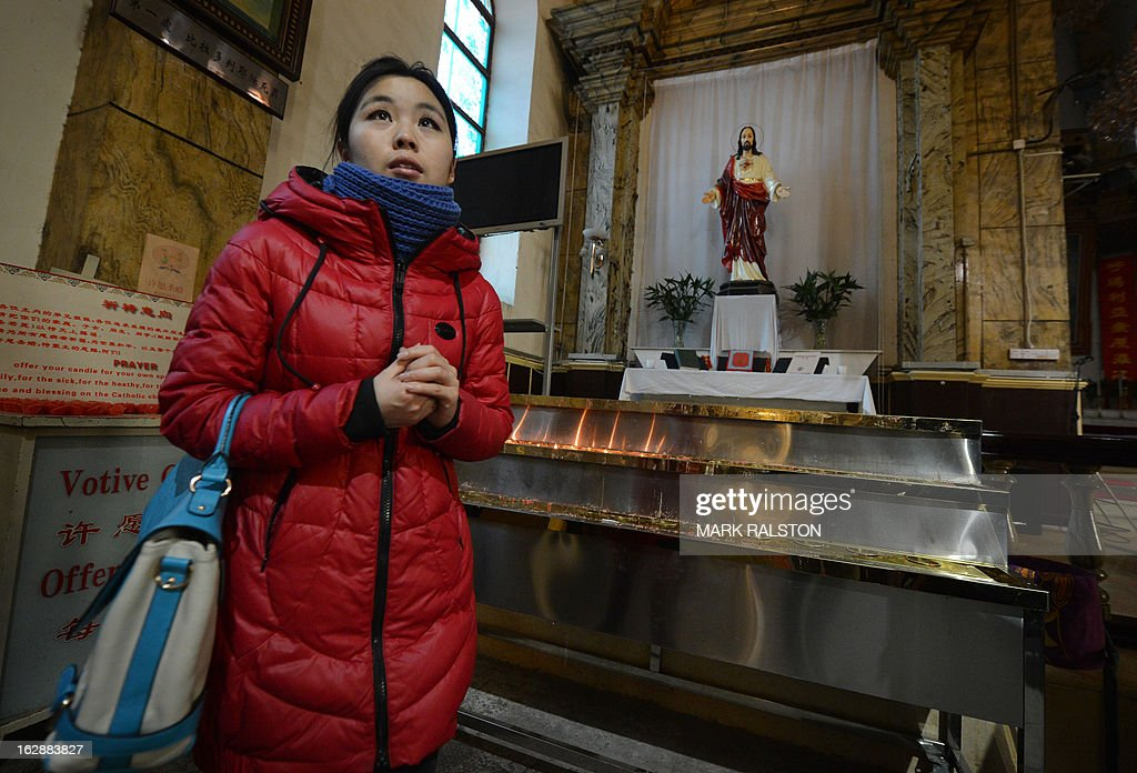 China-religion-Vatican-Catholic-pope,FOCUS by Kelly Olsen This photo taken on on February 20, 2013 shows a Chinese Catholic leaving after praying at the Cathedral of the Immaculate Conception in Beijing. Experts estimate that there are as many as 12 million Catholics in China, with about half in congregations under the officially-administered Chinese Catholic Patriotic Association. The rest belong to non-sanctioned or so-called underground churches, though despite the name many operate in the open, with experts saying levels of acceptance depend on local officials' attitudes. AFP PHOTO / Mark RALSTON