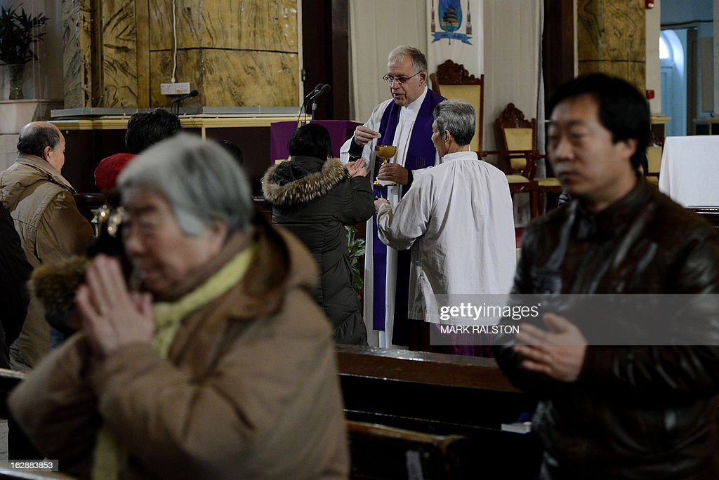 China-religion-Vatican-Catholic-pope,FOCUS by Kelly Olsen This photo taken on on February 20, 2013 shows priests (C) conducting mass for Chinese Catholics at the Cathedral of the Immaculate Conception in Beijing. Experts estimate that there are as many as 12 million Catholics in China, with about half in congregations under the officially-administered Chinese Catholic Patriotic Association. The rest belong to non-sanctioned or so-called underground churches, though despite the name many operate in the open, with experts saying levels of acceptance depend on local officials' attitudes. AFP PHOTO / Mark RALSTON