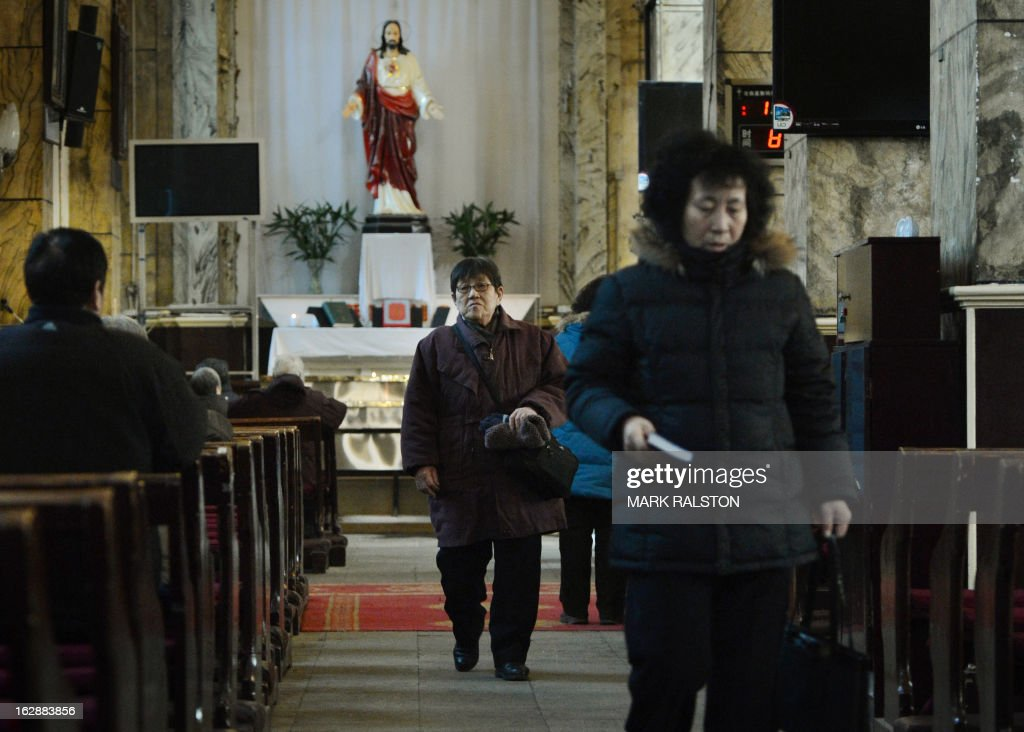 China-religion-Vatican-Catholic-pope,FOCUS by Kelly Olsen This photo taken on on February 20, 2013 shows Chinese Catholics during mass at the Cathedral of the Immaculate Conception in Beijing. Experts estimate that there are as many as 12 million Catholics in China, with about half in congregations under the officially-administered Chinese Catholic Patriotic Association. The rest belong to non-sanctioned or so-called underground churches, though despite the name many operate in the open, with experts saying levels of acceptance depend on local officials' attitudes. AFP PHOTO / Mark RALSTON