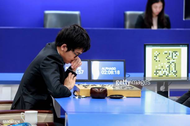 China's 19yearold Go player Ke Jie prepares to make a move during the second match against Google's artificial intelligence programme AlphaGo in...