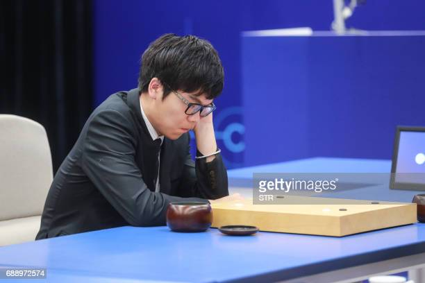 China's 19yearold Go player Ke Jie prepares to make a move during the final match against Google's artificial intelligence programme AlphaGo in...