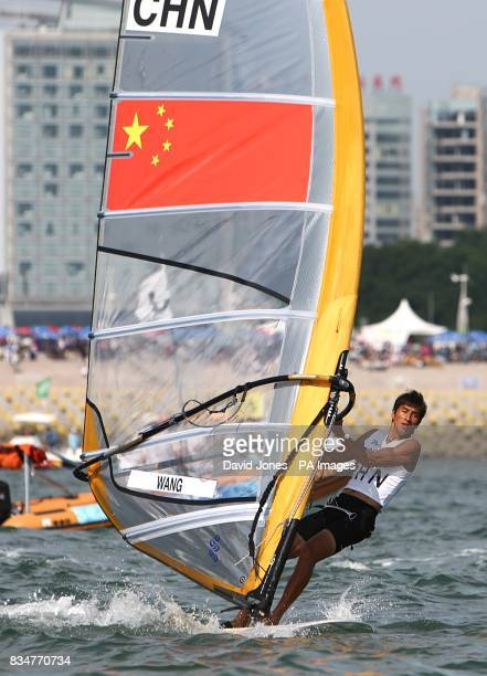 China's Aichen Wang during the final round of his RSX Sailing Competition at the Olympic Games' Sailing Centre in Qingdao on day 12 of the 2008...