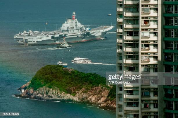 China's aircraft carrier Liaoning sails past residential tower blocks in Hong Kong on July 7 2017 China's national defence ministry had said the...