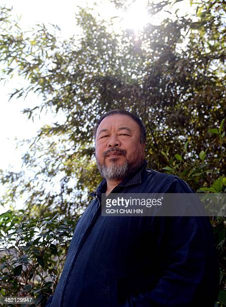 China's best known and boldest contemporary artist Ai Weiwei poses in the garden of his studio in the suburbs of Beijing on April 3 2014 The...