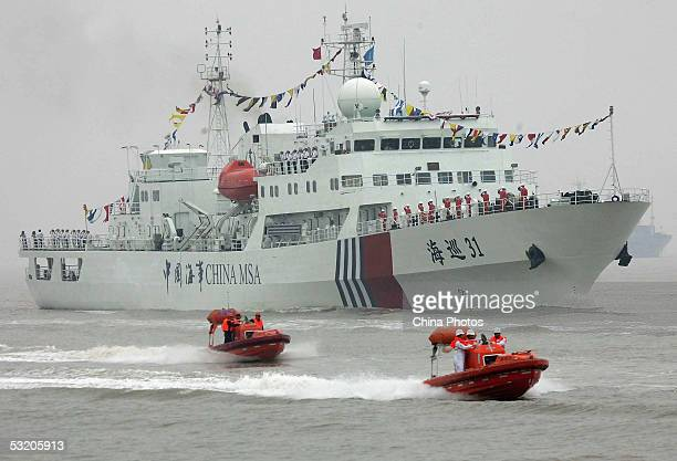 China's biggest and most advanced patrol ship 'Haixun 31' of Maritime Safety Administration takes part in a mission with patrol yachts during the...