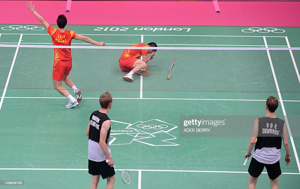 China's Cai Yun and Fu Haifeng (Top) celebrate after beating Denmark's Mathias Boe and Carsten Mogensen (Below) during the Men's Doubles badminton gold medal match at the London 2012 Olympic Games in London, on August 5, 2012.