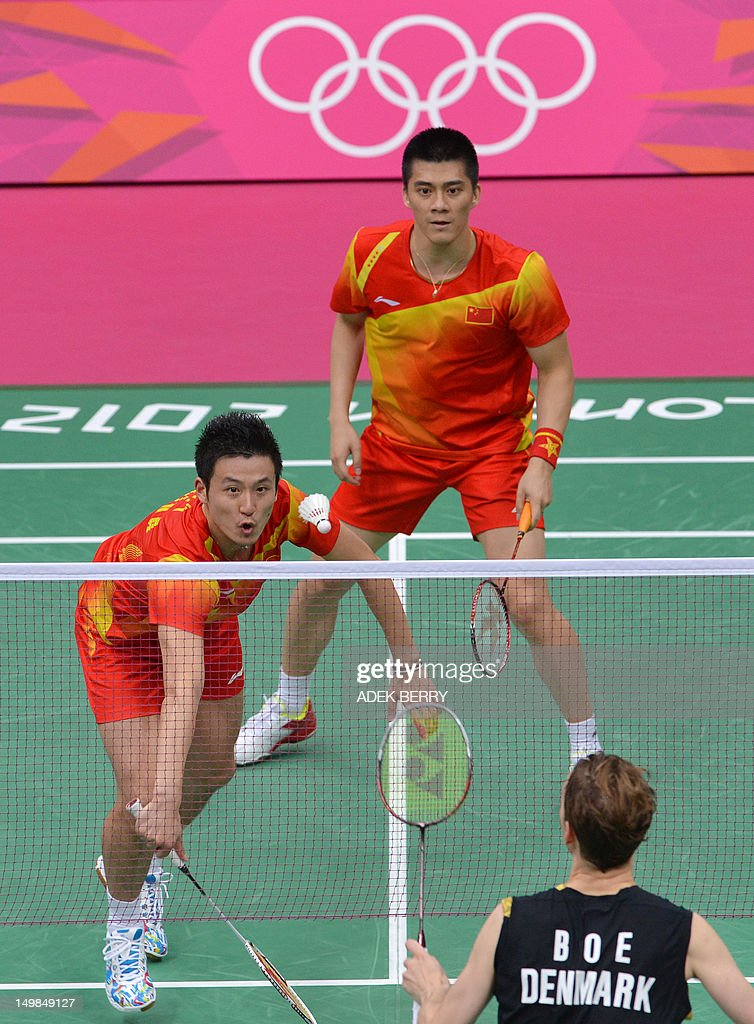 China's Cai Yun (L) and Fu Haifeng (R) play against Denmark's Mathias Boe and Carsten Mogensen in the Men's Doubles badminton gold medal match at the London 2012 Olympic Games in London, on August 5, 2012.