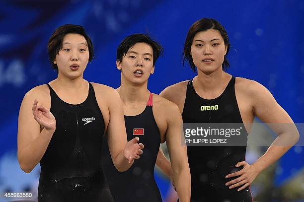 China's Cao Yue Guo Junjun and Tang Yi cheer on final lap swimmer Shen Duo during their victory in the final for the women's 4 x 200m freestyle relay...