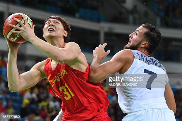 TOPSHOT China's centre Wang Zhelin jumps for the basket by France's power forward Joffrey Lauvergne during a Men's round Group A basketball match...