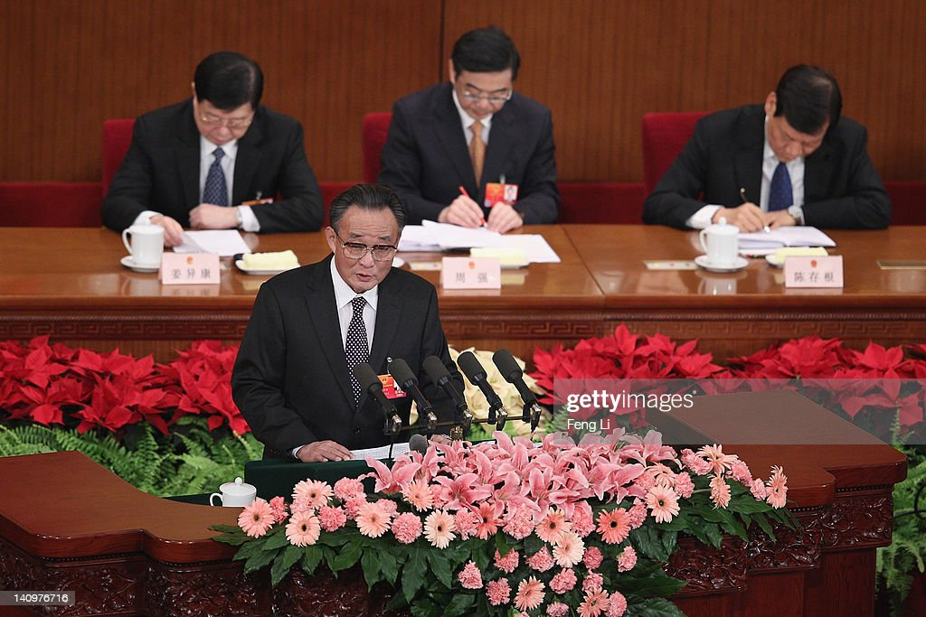 China's Chairman of the Standing Committee of the National People's Congress Wu Bangguo delivers his speech during the third plenary meeting of the...