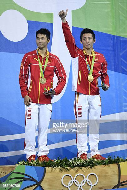 China's Chen Aisen and China's Lin Yue celebrate with their gold medal during the podium ceremony for the Men's Synchronised 10m Platform contest...