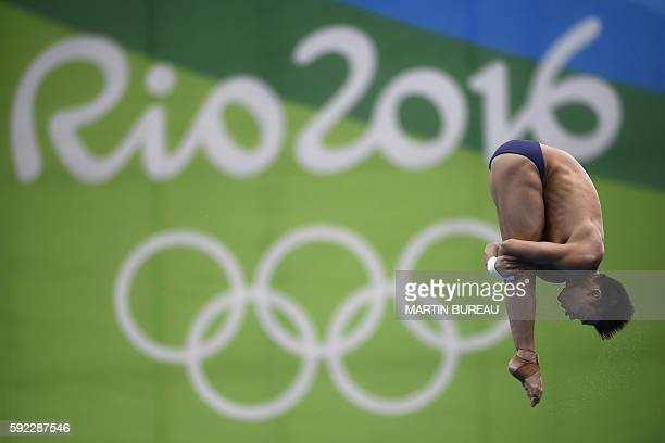 China's Chen Aisen competes in the Men's 10m Platform Semifinal during the diving event at the Rio 2016 Olympic Games at the Maria Lenk Aquatics...